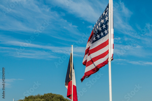 Poster american and french flags in a reconstituted military camp