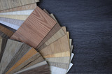 Fototapety Laminate Wood Concept - Samples of laminate and vinyl floor tile on wooden Background wo