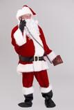 Full size photo of Santa talking on phone