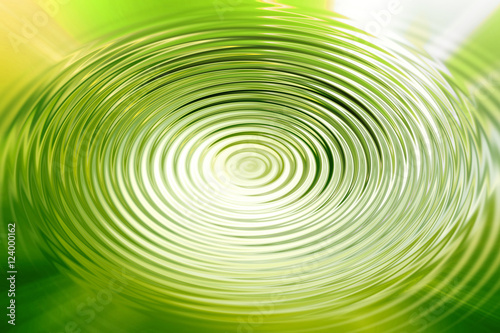Abstract green shiny swirling water pattern effect background. Artistic circle blurred spin water background.
