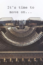 It's time to move on motivational message written with a vintage typewriter