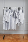 Medical clothes in row on floor hanger.