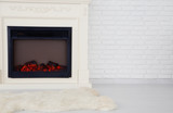 Decorative fireplace in an empty apartment