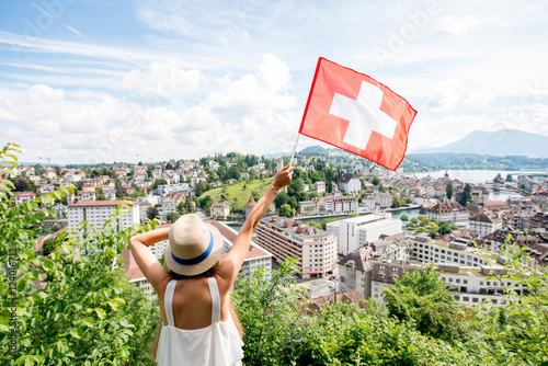 Young female traveler enjoying great view on Lucerne cityscape in Switzerland Poster