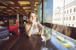Woman in restaurant with glass of wine