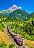 Intercity train climbs up the Gotthard railway - Switzerland