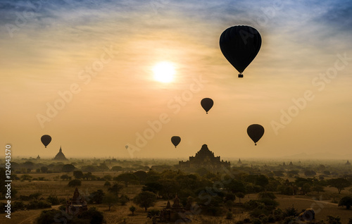 Poster Hot air balloon over misty morning around Temple in Bagan , Myan