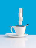Cup with coffee, sugar and spoon.