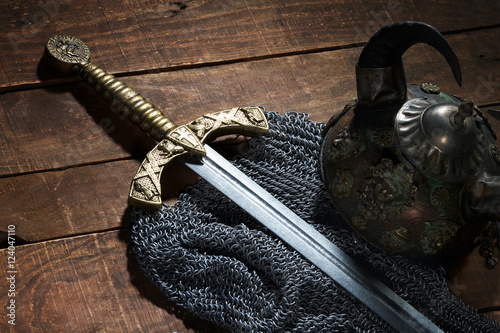 ancient sword, chain armor and the soldier's helmet with horns o
