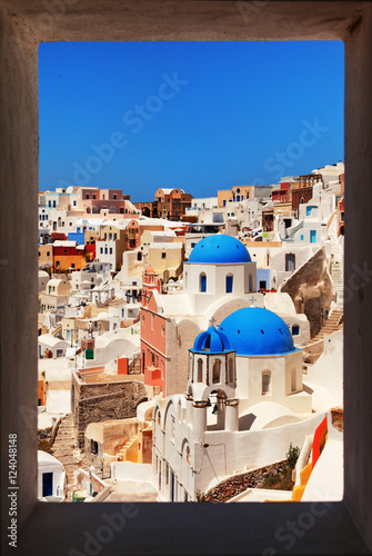 Foto op Canvas Famous churches of Oia, Santorini. Framed view. Vertical shot.