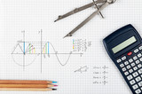 Mathematics concept, sine function - calculator, compass and coloring pencils  - 124060344