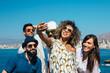 Positive friends makes selfie outdoors