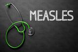 Measles - Text on Chalkboard. 3D Illustration.