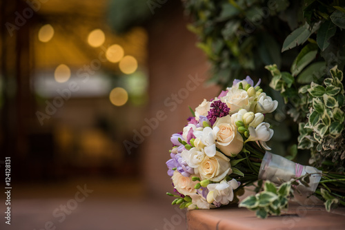 Wedding bouquet with freesia and roses