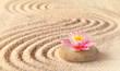 Sand, flower lily and spa stones in zen garden