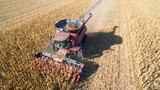 Agricultural Harvesting Corn with a Combine - 124152157