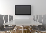 Conference room with blank LCD TV in background