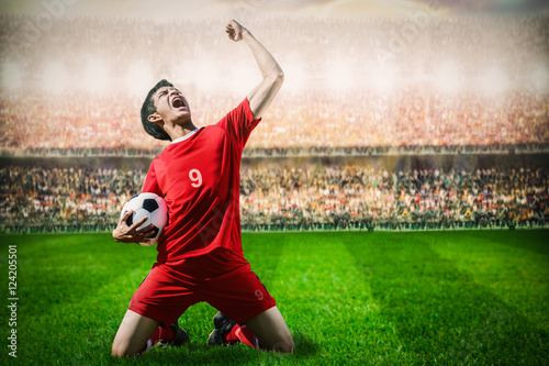 striker soccer football player in red team concept celebrating g Poster