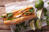 Vietnamese sandwich with cilantro and carrot close-up. Horizontal top view
