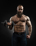 Strong bearded bodybuilder with six pack, perfect abs, shoulders