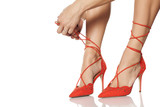 woman tied the shoelaces on her high heels