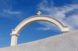 white arch with cross in Oia on Santorini
