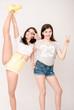 Positive friends portrait of two girls, funny faces, grimaces