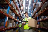 Warehouse worker using scanner - 124255344