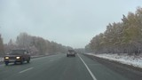 Early snow in October in Siberia, commuter highway