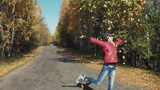 Girl throwing Golden leaves,enjoying the autumn