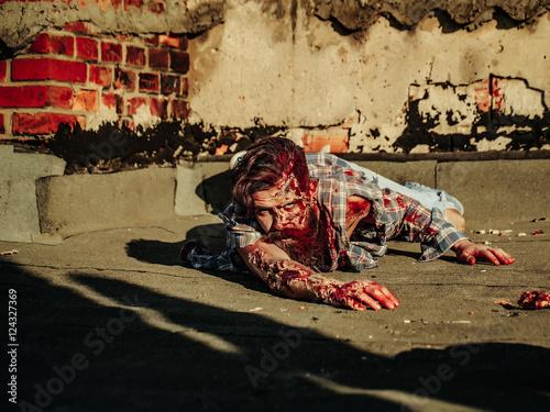 Zombie man crawls on asphalt Poster