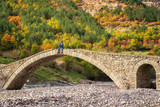 Autumn forest / Amazing view with old bridge and a woman enjoying the autumn forest in Eastern Rhodopes, Bulgaria