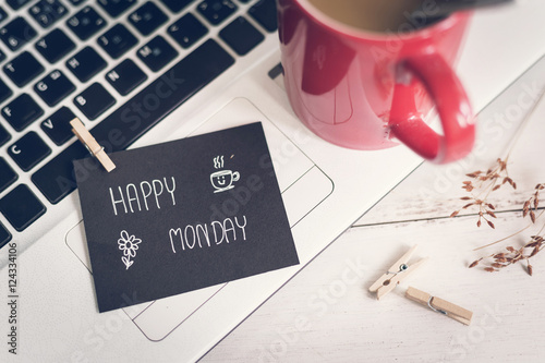 Happy Monday massage on notebook with coffee