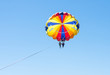 Happy couple Parasailing in Dominicana beach in summer. Couple under parachute hanging mid air. Having fun. Tropical Paradise. Positive human emotions, feelings, joy.