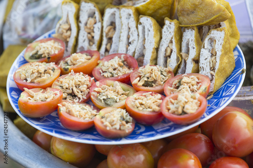 Poster Tomatoes and fried tofu cut, stuffed with nuts, dried shrimp and fermented tea f