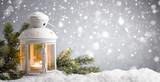 lantern with snowfall