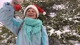 Woman Happy in Santa Hat Decorates a Christmas Tree in the Forest Slow Motion
