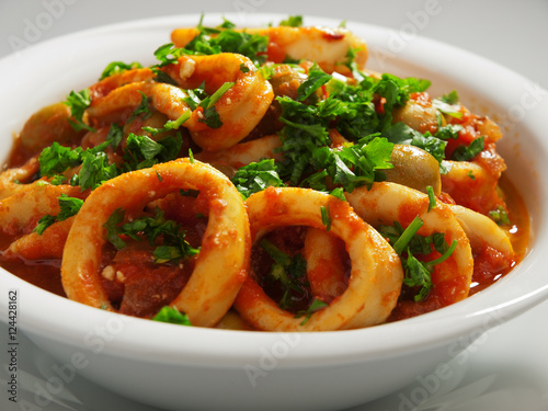 Calamari stewed in tomato and onion sauces with olives ...