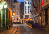 Night view of a street in Riga that is the capital and largest city of Latvia, a major commercial, cultural, historical and tourist center of the Baltic region