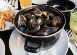 Belgian lunch: steamed mussels, french fries and beer - 124462148
