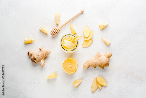 Ginger-lemon drink in a bottle with a straw Poster