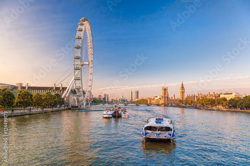 Sunrise with Big Ben, Palace of Westminster, London Eye, Westminster Bridge, River Thames, London, England, UK.