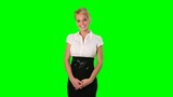 Cheerful young businesswoman posing against a green screen background; alpha channel included