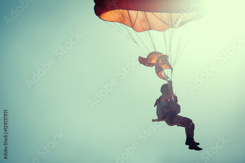 Poster Skydiver On Colorful Parachute In Sunny Clear Sky.