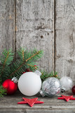 Fototapety Red, silver and white xmas ornaments on rustic wood background. Merry christmas card. Winter holiday theme. Happy New Year. Space for text.