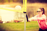 Woman volleyball player outdoor on court