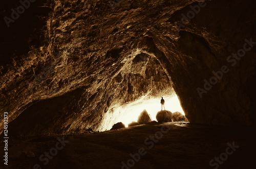 cave explorer at cave entrance Plakát