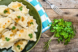 Homemade dumplings with fried onion on plate, top view, cooking concept - 124612122