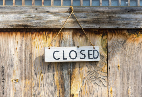 CLOSED - sign on the wooden wall - 124628139
