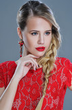Fashion woman closeup portrait with red lipstick and trendy bohemian braids hairstyle wearing fancy earrings and lace dress
